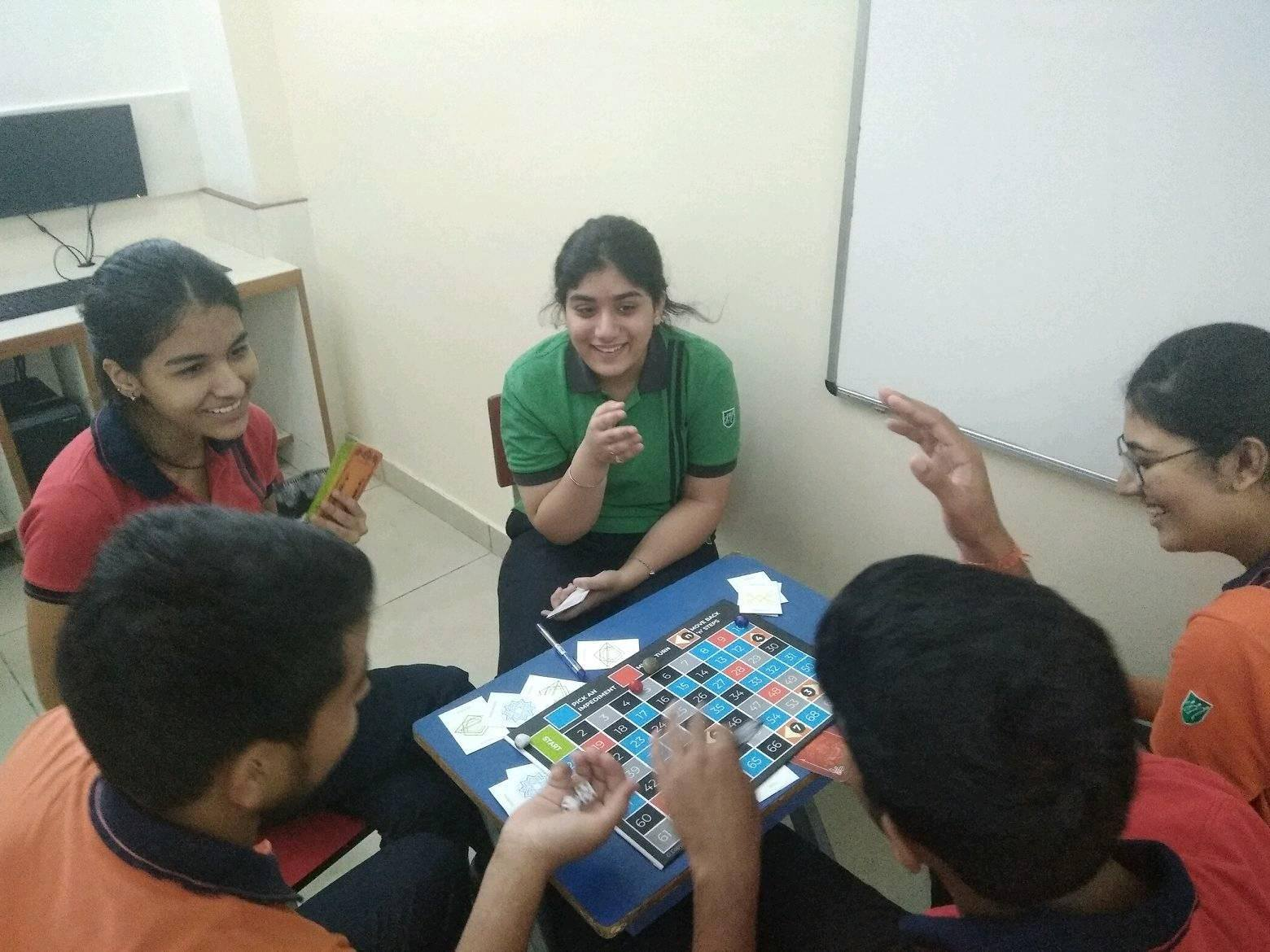 Students from DAV Public school in Jalandhar playing the board game.